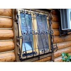 Кованые решетки на деревянный дом