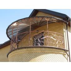 Кованый козырек с полукруглой крышей из поликарбоната